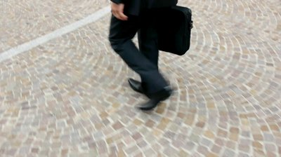 stock-footage-close-up-of-legs-and-feet-of-businessman-walking-with-suitcase[1]